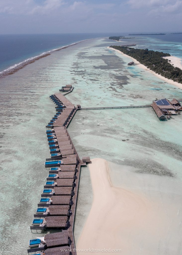 A row of overwater villas in the Maldives from a drone shot