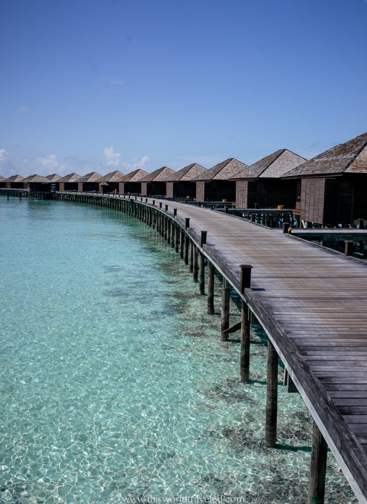 Row of over the water bungalows at Lily Beach Resort & Spa in the Maldives
