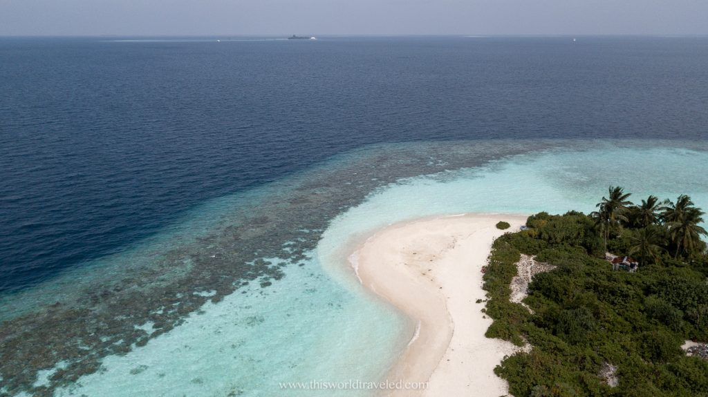 a private island with white sand and turquoise water in the Maldives