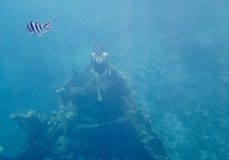 Girl snorkeling at the skeleton wreck shipwreck in Coron, Philippines