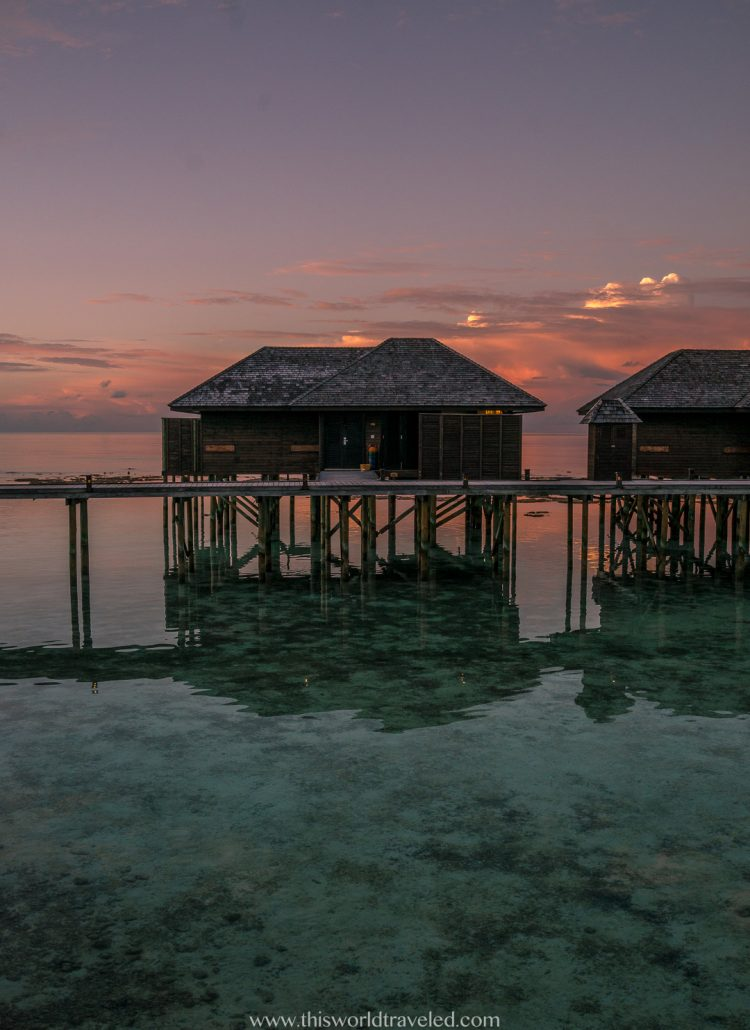 Over the water bungalows at sunset on Lily Beach Resort & Spa in the Maldives