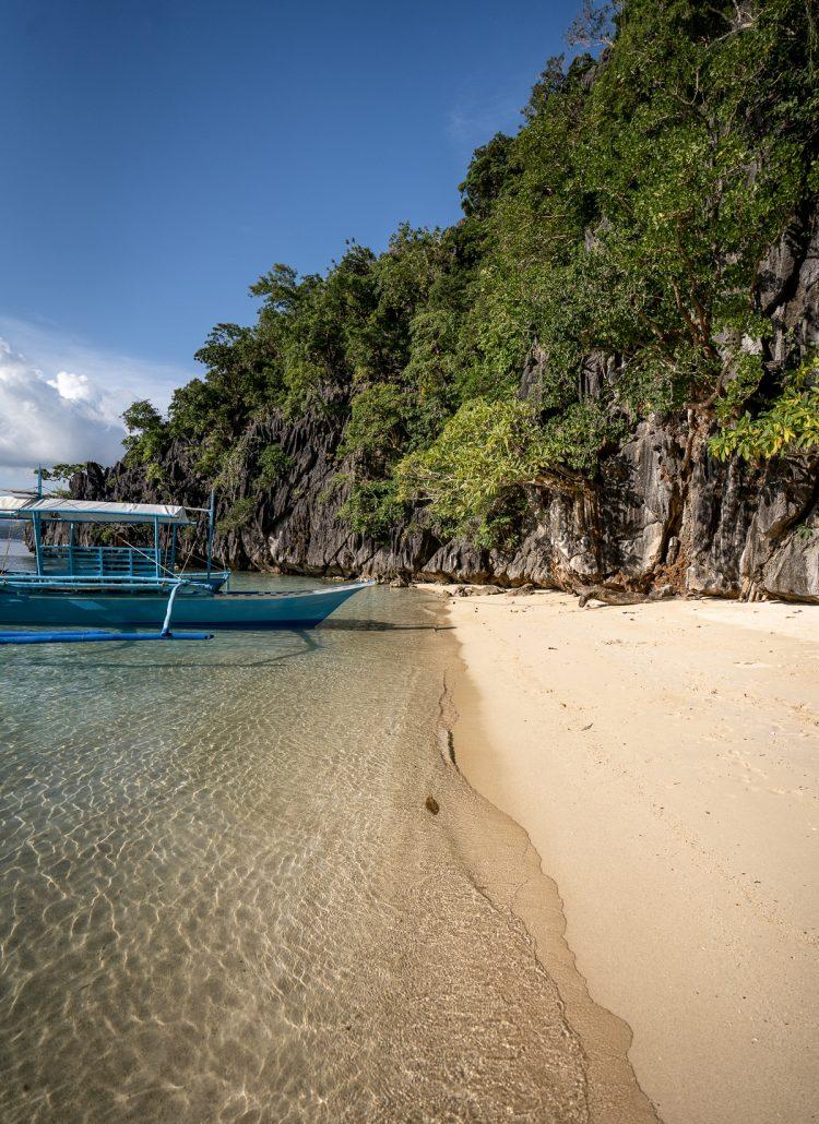 Watching sunset on Vivian Beach while island hopping in Coron, Palawan