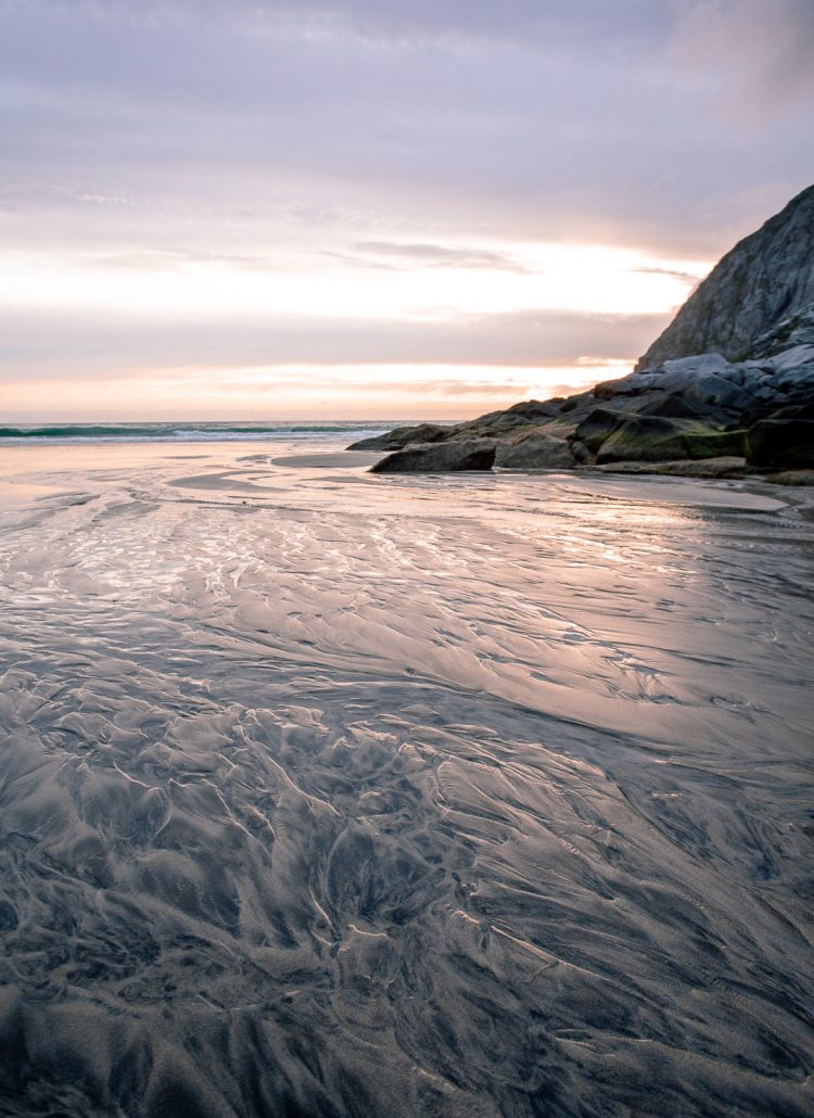 The indentations in the sand from the waves crashing on the beach in the Lofoten Islands