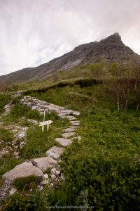 A stone hiking trail that leads to a secret beach in the Lofoten Islands, Norway