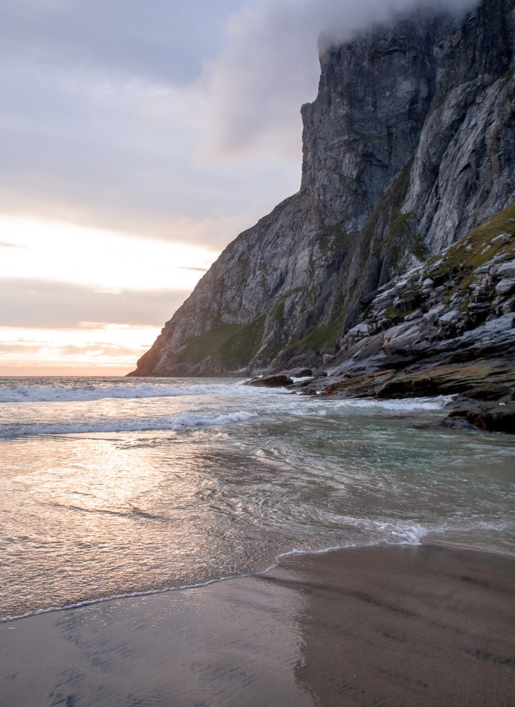 Water crashing up on the sandy beach of Kvalvika in the Lofoten Islands