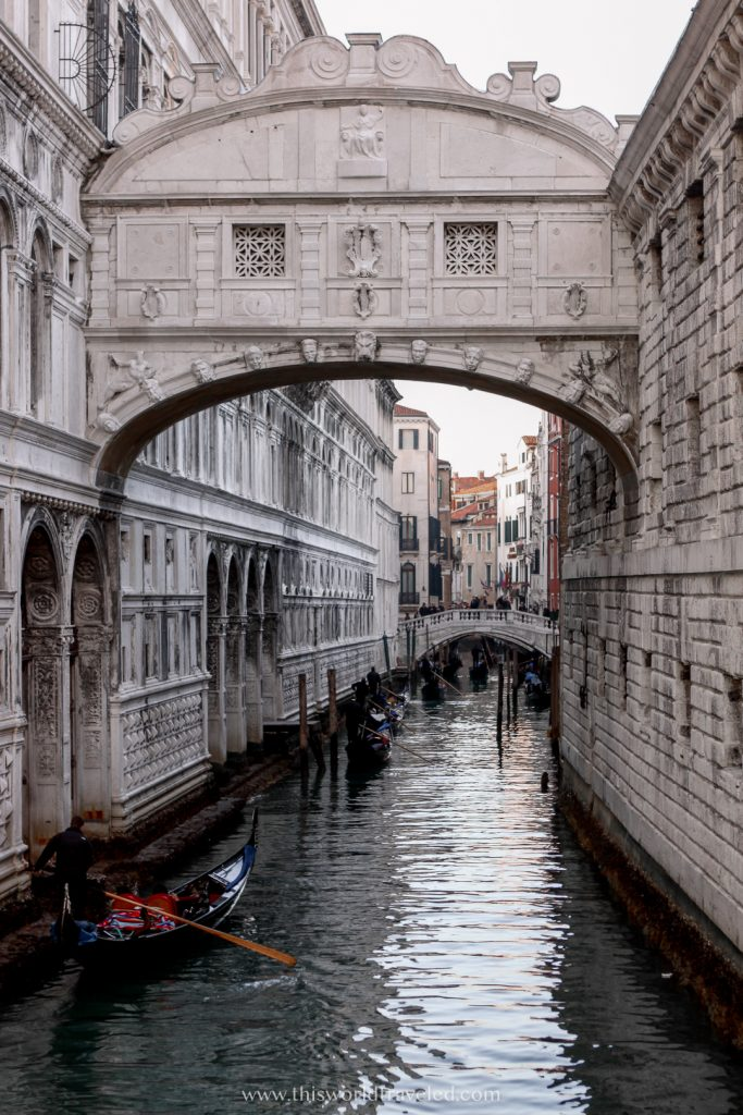 The Bridge of Sighs has a intricate architecture and archway and is located along Venice's Grand Canal