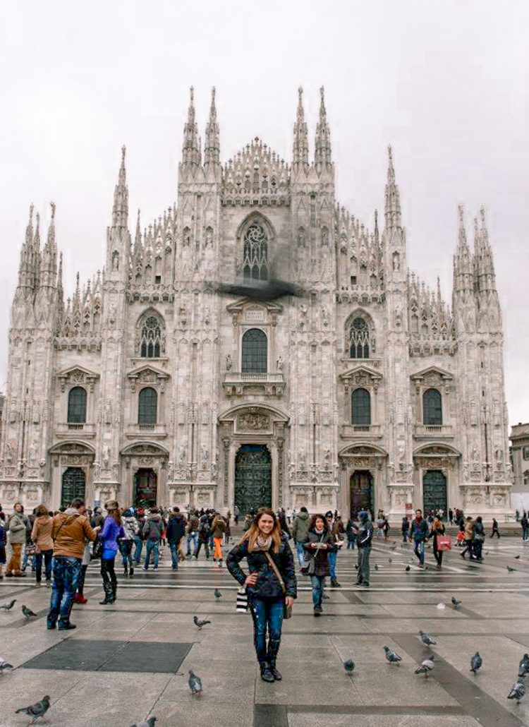 The Duomo di Milano with large spires and intricate details located in Milan, Italy