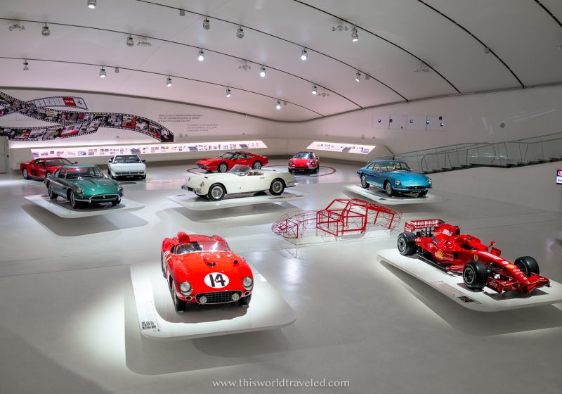 A large industrial hanger filled with different makes and models of Ferrari's inside the Enzo Ferrari Museum in Modena, Italy