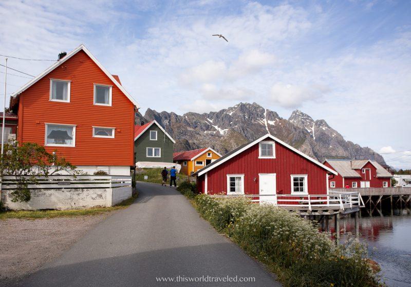 The small town of Henningsvær with red, orange and yellow fisherman huts