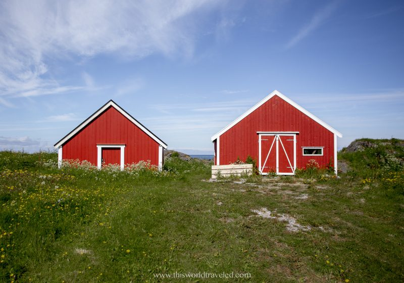Two red Rorbuer near the beach in Hov in the Lofoten Islands