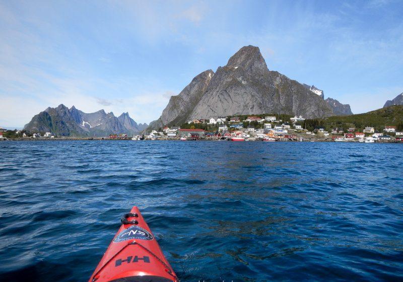 A red kayak in the Reinefjord near Reine in the Lofoten Islands in Norway
