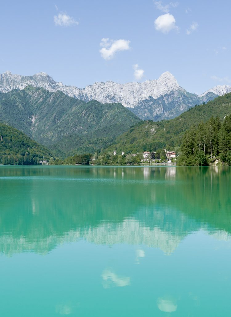 The emerald water of Lake Barcis in northern italy with surrounding mountains