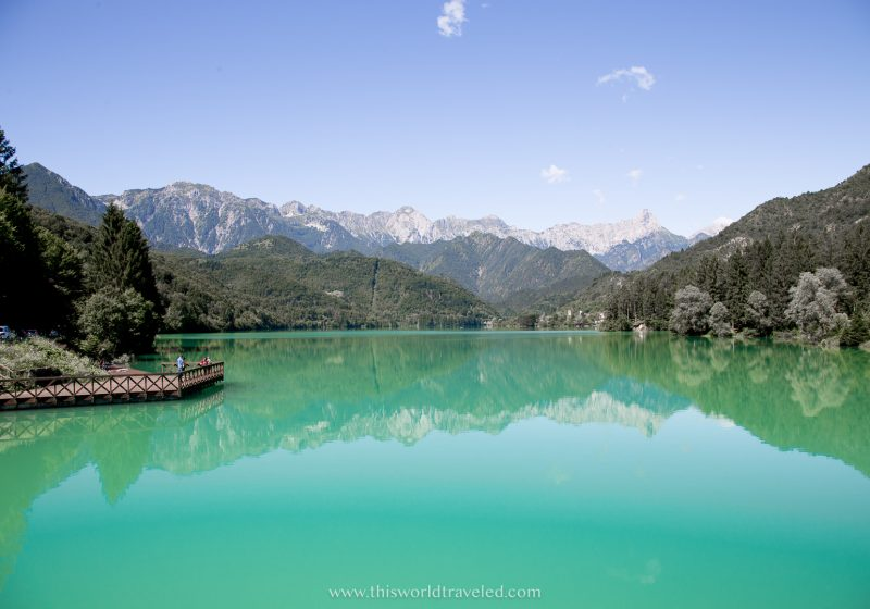 The emerald water surrounded by a small town and mountains of Lake Barcis is one of the best places in northern Italy