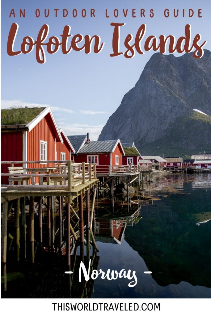 A line of red fishing huts on the water with a large mountain in the back. These fishing huts are located in Reine, Norway in the Lofoten Islands