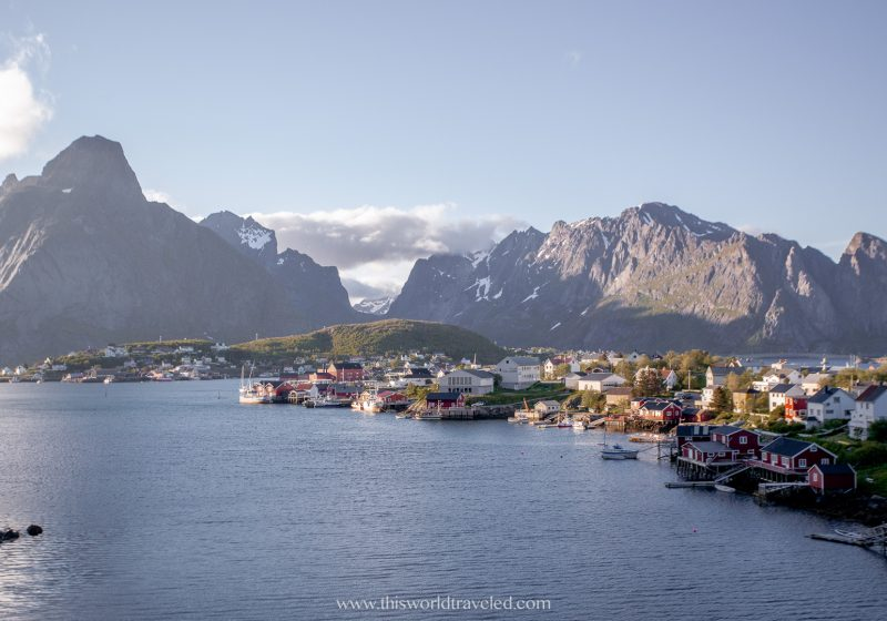 A small fishing village in the Lofoten Islands with large mountains in the back