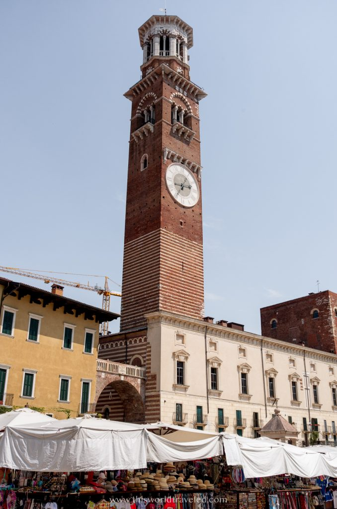 A large clock tower in Verona's main square Piazza Bra in Italy