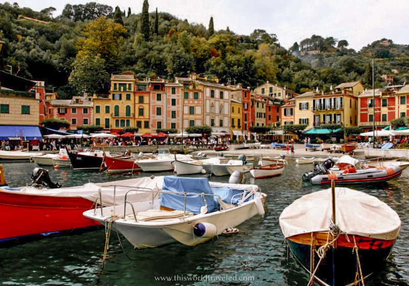 The small town of Portofino with colorful houses and boats in a harbor is one of the best places to visit in northern Italy