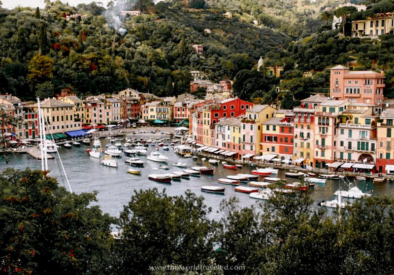 Colorful buildings and boats in a harbour in Portofino in northern Italy