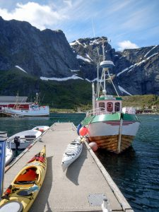 The dock in Reine, Lofoten Islands with 2 kayaks and a fishing boat
