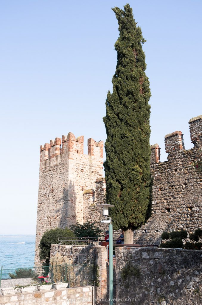 Views of the Sirmione castle and a large tree near Lake Garda, Italy