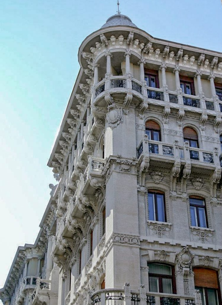 A white stone building located in Trieste in Italy