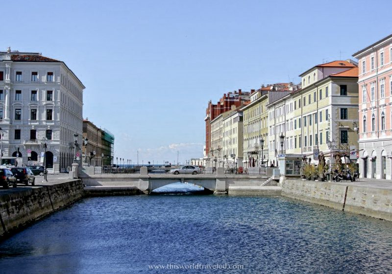 The bridge in Trieste, Italy with views of the harbor and surrounding Italian buildings