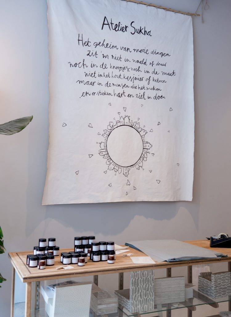 A sign behind the counter at Sukha boutique shop in Amsterdam