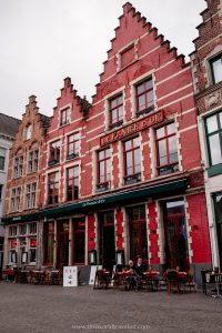 The distinct red and copper colored houses in Bruges Markt Square in Belgium