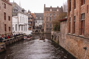 Brick buildings lining a canal in Bruges, Belgium