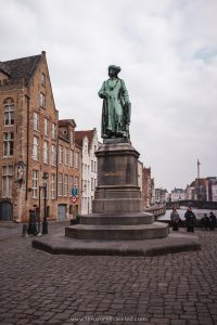 a large statue located in the center of Bruges Square in Bruges, Belgium
