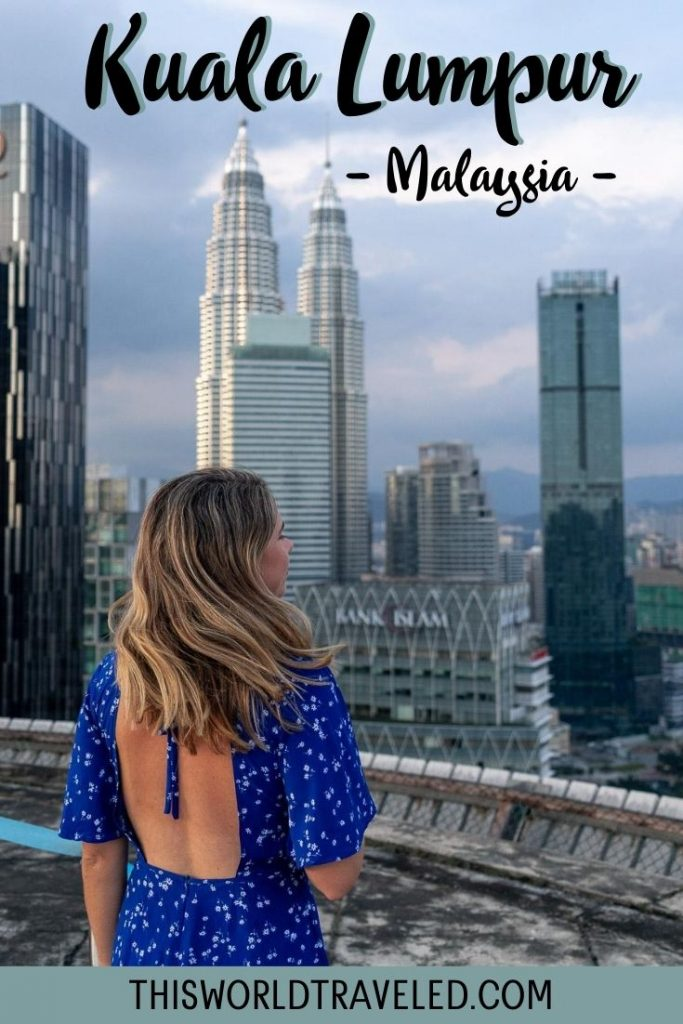 Girl standing on a rooftop in Kuala Lumpur, Malaysia with views of the Petronas Twin Towers