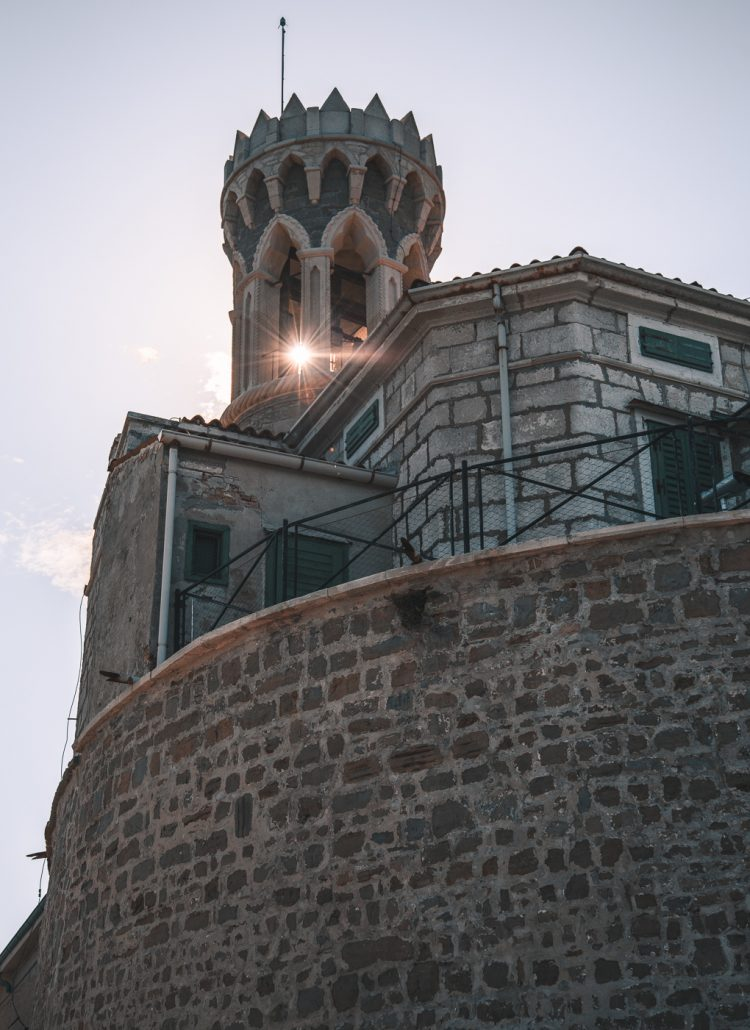 A large brick structure in Piran with a sun beam