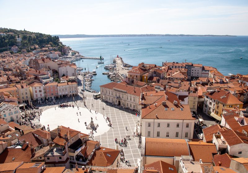 Orange roofed houses and a view of the Adriatic sea from the bell tower in Piran, Slovenia