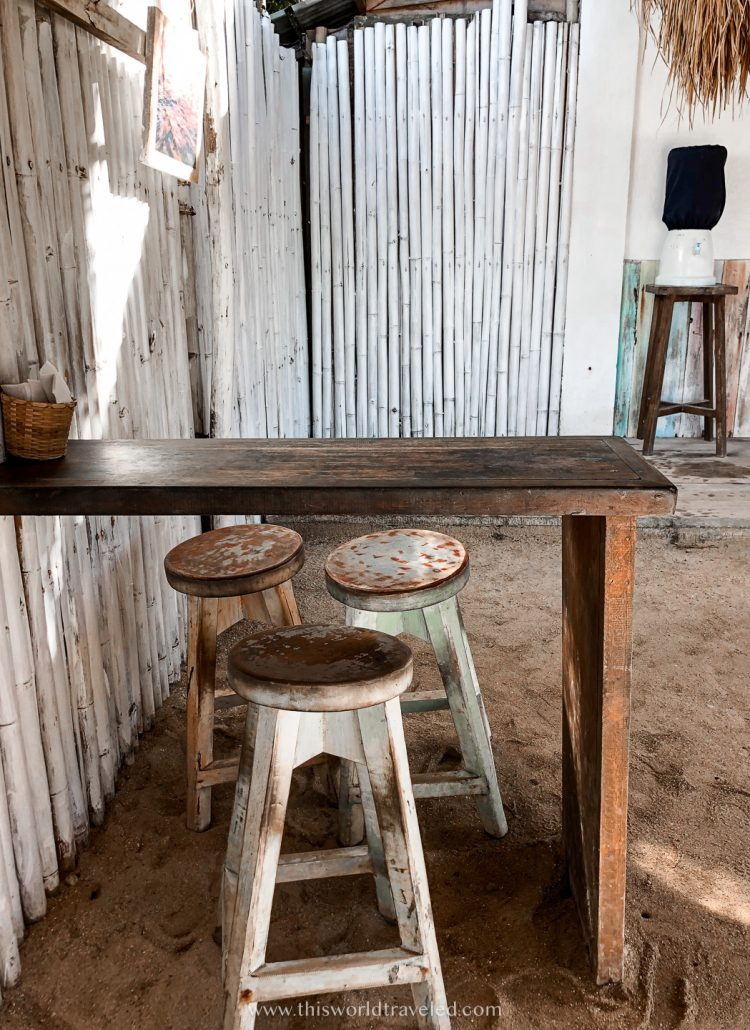 A small table and stools at a smoothie shack called Shaka Cafe in Siargao
