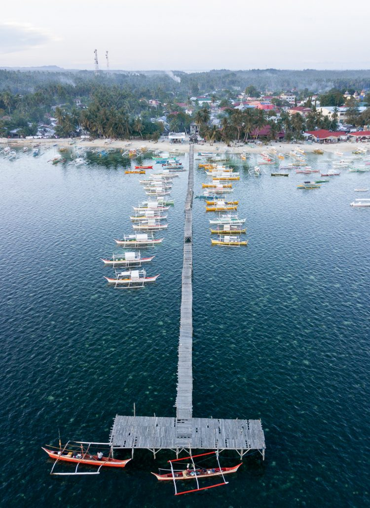 Drone shot of the harbor on the island of Siargao in the Philippines