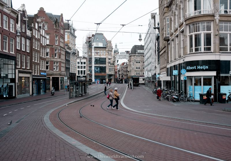 The tram lines that run through the center of Amsterdam with surrounding buildings