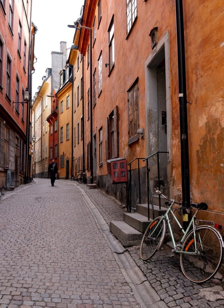 orange and yellow houses lining an alleyway in Stockholm