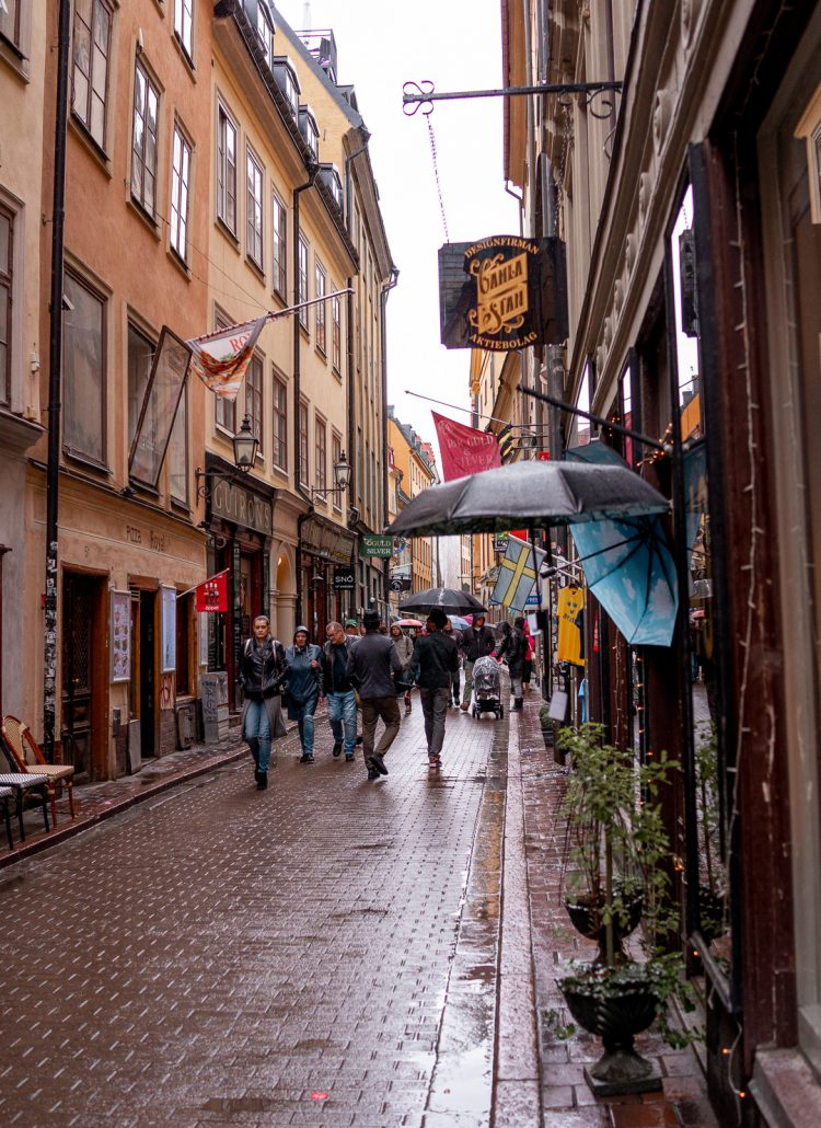 The colorful streets of Gamla Stan and a sign for Designfirman