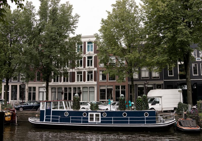 A houseboat parked along an Amsterdam canal