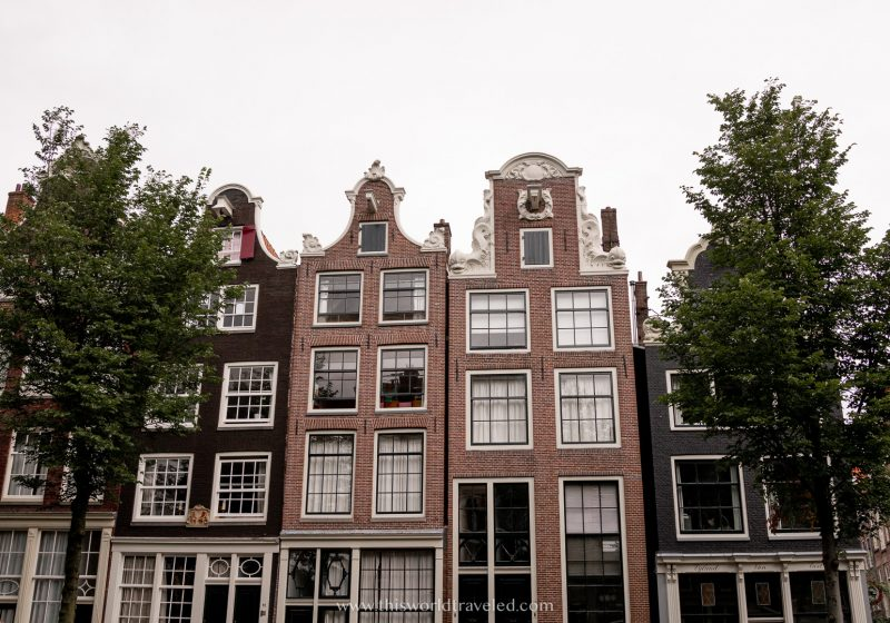 Brown row houses in Amsterdam with unique architecture
