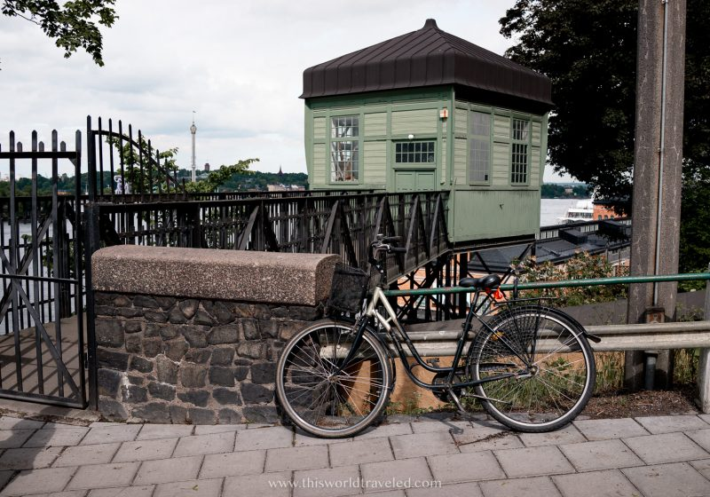 A bike parked outside a green house in Stockholm