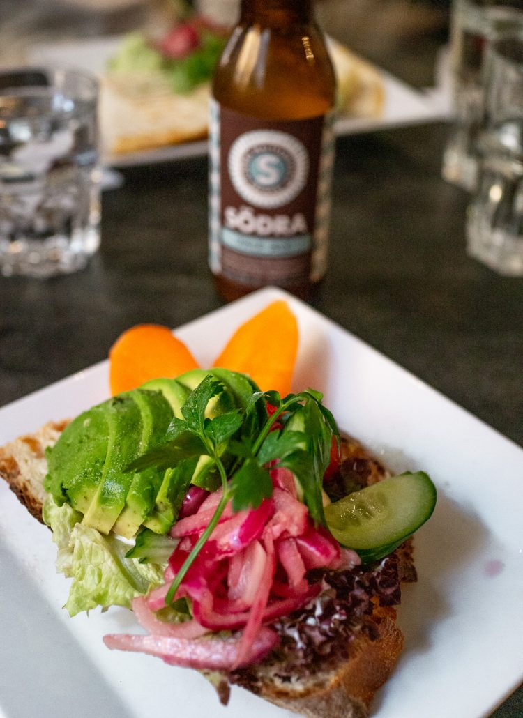 Avocado toast and a beer served at Louie Louie in Stockholm, Sweden