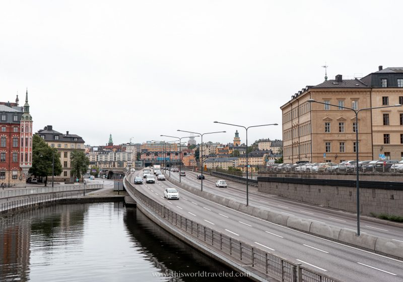 A long road with cars and buildings in Stockholm, Sweden