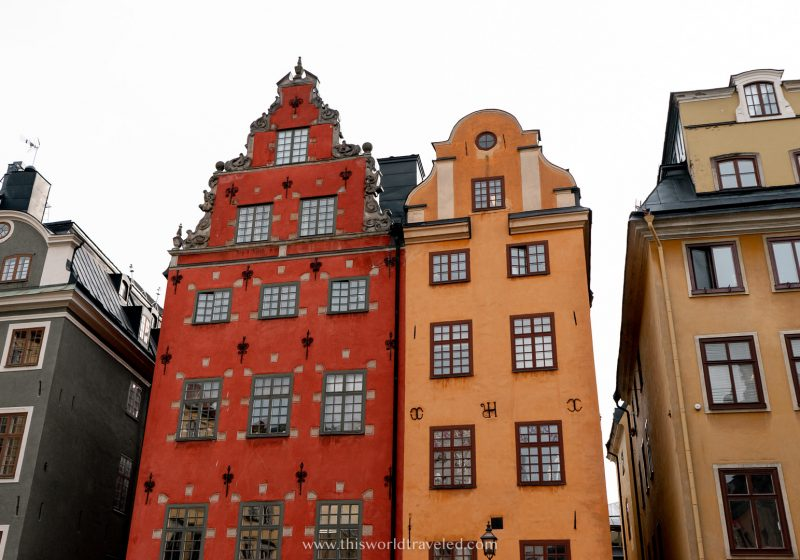 Red, yellow and green buildings in a large square in Stockholm, Sweden