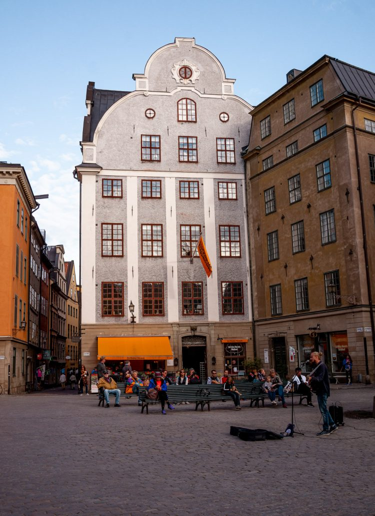 Grey and yellow buildings in a large square in Stockholm, Sweden