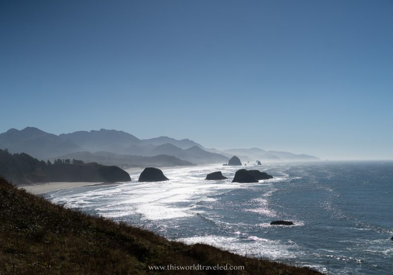 Views of the ocean and large rock formations jutting out from the sea along the Pacific Northwest coast