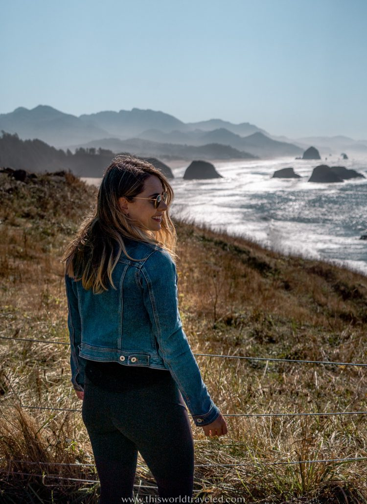A girl in a jean jacket overlooking the ocean