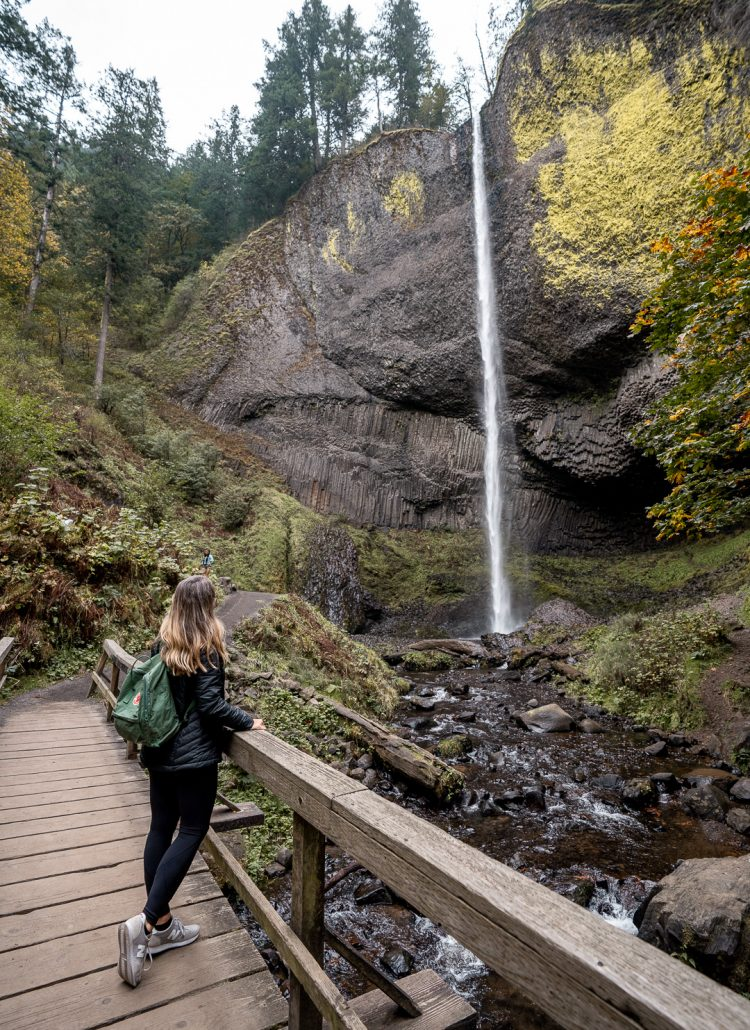 Girl standing on a wooden bridge at Latourell Falls in Portland, Oregon