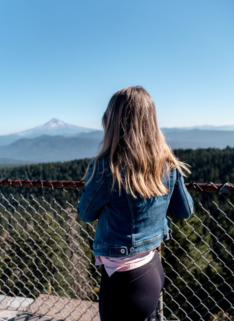 Girl standing at the Sherrard Point viewing deck in Portland