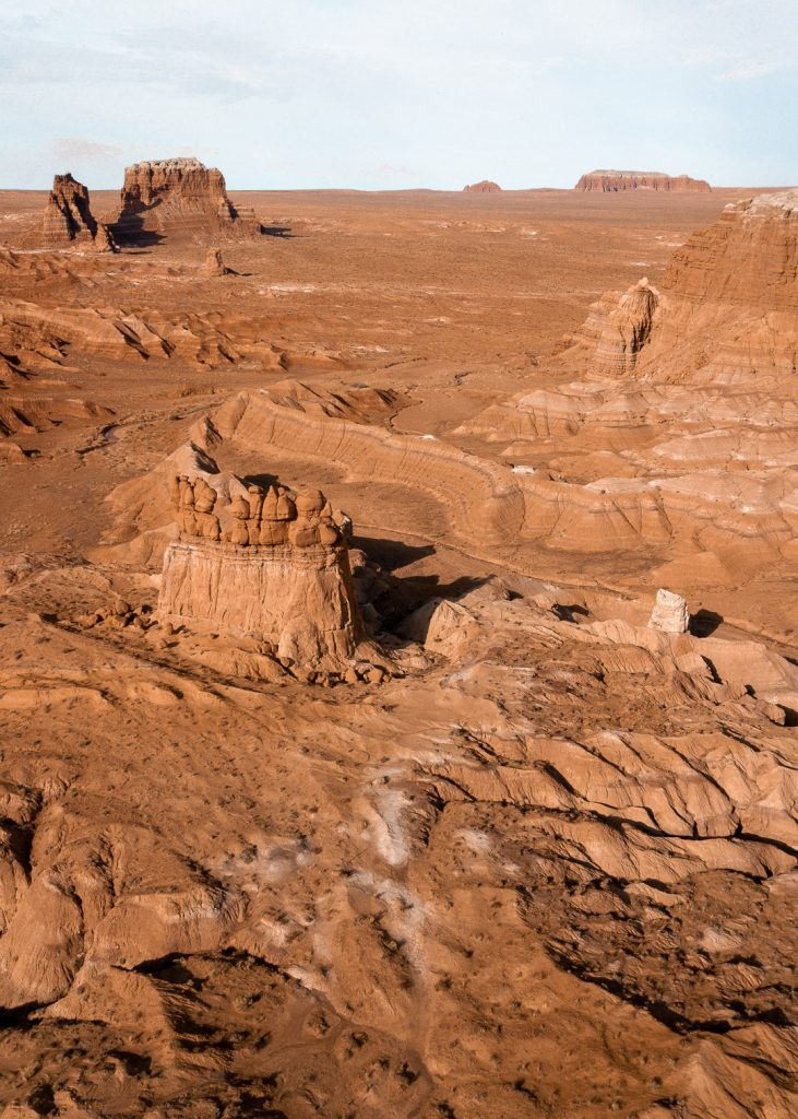 Towering rock formations and red rocks in Goblin Valley State Park on a Utah road trip